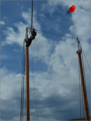 Stepping the new mast on Seattle historic schooner Lavengro